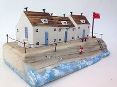 Handmade driftwood cottage. This one off piece is made from driftwood and recycled material from the Cornish coast. The cottage will look great on display in any room in your house. Measurements 95mm high 200mm long 100mm width