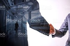 Double exposure of two business persons shaking hands and modern cityscape, relationship conceptual abstract zbiór zdjęć royalty-free