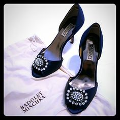"""BADGLEY MISCHKA Lacie Peep Toe Navy Pumps Elegant navy satin peep toe pumps with rhinestone embellishment.  3 in heel.  Comes in original box, wrapping, and Badgley Mischka shoe dust bag. Heel stud replacements included. Worn only once (my wedding day for around 2 hours) and in perfect condition! The only sign of wear is on the sole, picture 4, and that's because the sole is 100% leather.  The perfect """"something blue"""" for your wedding day or just a glamorous pair of pumps for any occasion…"""