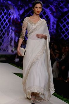 Varun Bahl indian designer runway couture 2016 collection online. an ivory georgette saree with a fully pearl encrusted raw silk border. It comes along with a matching raw silk blouse with gold embellishments around neckline and pearl and thread work all over. Shop now on www.carmaonlineshop.com #ICW2016 #VarunBahl #carmaonline #couture #romantic #floral #lehenga #embroidery #designer #delhi #wedding #whimsical #shoponline