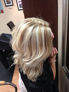 Cool blonde with lowlights #daisysalon I'd like this with red and black