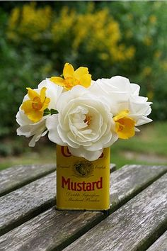 :Table Setting or Centerpiece creatively made with Colman's Mustard Tin via crumpledenvelope on tumblr: