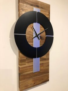 Quality quartz solid acacia timber wall clock, trimmed in matte black and brushed aluminium