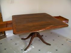 Table top when with leafs up and drawers open x . With leafs folded down x Inlaid wood veneer. Pedestal with lion's claws. Top needs some refinish. Dining Table With Drawers, Pedestal Dining Table, Wood Veneer, Drafting Desk, Claws, Construction, Antiques, Top, Furniture