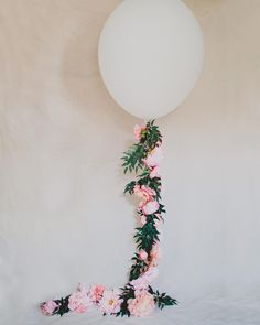"""Want to incorporate <a class=""pintag"" href=""/explore/peonies/"" title=""#peonies explore Pinterest"">#peonies</a> into your wedding day but getting married in the fall or winter? Why not make this pretty Floral Balloon wrapped with silk…"""