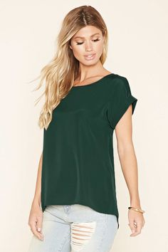 A classic top featuring cuffed short sleeves and a round neckline.