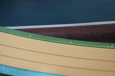 Colorful boat out of water, Gloucester, MA.