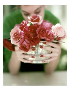 Vogue - June 1952    Roses are beautiful to look at, but scent is everything. John Rawlings captured one of life's simple pleasures for the June 1952 House & Garden.