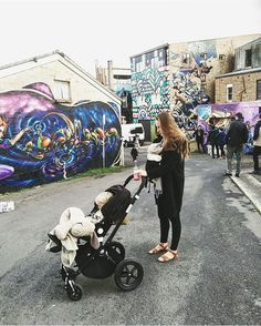 'Strolling' through the street art at the Winter Magic Festival ❄️✌️🍄🌼 baby strapped on ✔️ toddler in stroller✔️ drinking fresh local kombucha ✔️ rugged up✔️