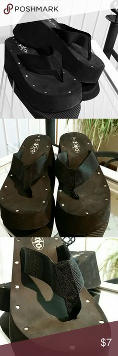 SOHO Black Platform Flip-flops w/Rhinestone detail I bought these SOHO Black Platform Flip-flops w/Rhinestone detail for my mom,  but she couldn't walk in them (she had MS). I tried them on around my house,  but they are a bit too big for me. Cute. Great for shorts weather or wearing on vacation at the beach. Only worn those two times to try on. Very little wear.   Smoke-free home & wearer. All shoes kept in plastic boxes. Soho Apparel Shoes Sandals