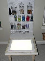 Light panel with light panel accessories on peg board