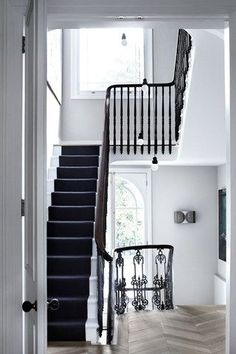 West London townhouse, interior design by Suzy Hoodless London Townhouse, London House, London Street, Black And White Stairs, Black Dark, Black Painted Stairs, White Hallway, Black Rug, Painted Staircases