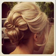 Romantic, loose updo . because I want my hair to get long again. and I think this would look pretty with a veil.