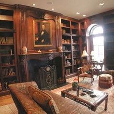 Love the woodwork with all those bookshelves.  And it is cozy enough it just sit and read here!  Ahh!