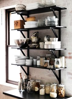 Cute open shelving for small apartment kitchens!