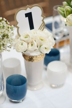navy and gold themed wedding table decor. @Mandy Dewey Seasons Bridal
