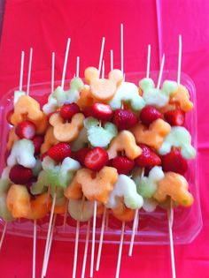 Mickey Mouse fruit ka bobs, for a mickey mouse birthday party. Mickey cookie cutter to the fruit.
