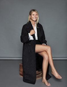 Taking a seat, Gwyneth Paltrow poses in Stella McCartney coat and blouse with Tous jewelry   Love this Jacket