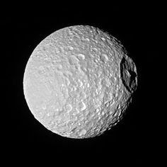nasa That's no moon... oh wait, yes it is. It's Saturn's moon Mimas and it's large Herschel Crater. Shadows cast across the moon, provide an indication of the size of the crater's towering walls and central peak.  Named after the icy moon's discoverer, astronomer William Herschel, the crater stretches 86 miles (139 kilometers) wide -- almost one-third of the diameter of Mimas (246 miles or 396 kilometers) itself. Large impact craters often have peaks in their center. Herschel's peak stands…
