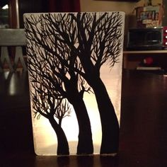 Hand painted glass vase turned into a votive candle holder.
