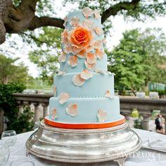 Gorgeous wedding cake with orange flowers.