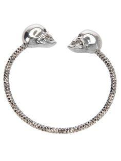 Alexander McQueen twin skulls bracelet.