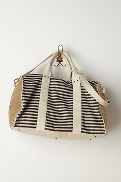 Weekender Bag from Anthropologie. Love the sequins and stripes!