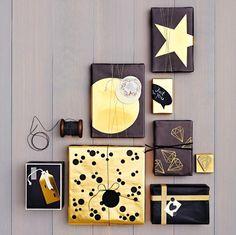 Geschenke sollen an Weihnachten besonders festlich aussehen. Was gibt es da besseres als Papier und Anhänger in Gold und Schwarz?