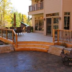 I like this curved step idea leading to a stone patio area.