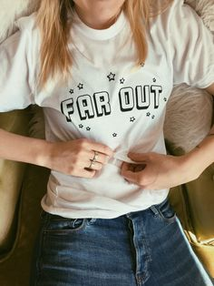 Far Out Tee Available in White Sizes S, M, L 50% Polyester/ 50% Cotton Made and Printed in small batches in the USA