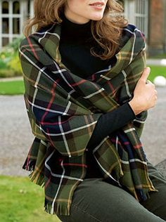 A green, blue, red, white and yellow tartan blanket/shrug. This looks absolutely beautiful and classy.