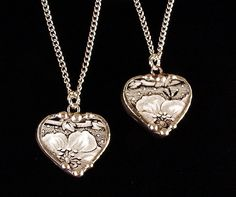 Matching hearts broken china jewelry plate pendants set of two black white floral toile. $85.00, via Etsy.