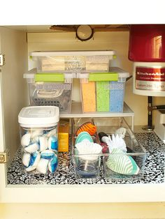 In the Kitchen Maximize the top half of the cabinet box. Stacking shelves smartly fill this space, allowing some items to slide underneath and others to stack on top. Tightly sealed plastic bins keep sponges from drying out, while airtight containers keep dish-washing pellets moisture-free.