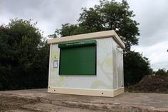 A newly-installed Food Cube at Tudor Grange Academy. The academy has since added new decking and seating areas around the Cube to create a mini outdoor cafe area. Roller Shutters, Outdoor Cafe, Shed, Seating Areas, Outdoor Structures, Decking, Tudor, Cubes, Create