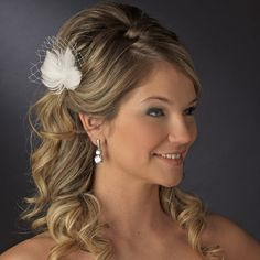 Feather Fascinator with Swarovski crystals & Veil Accent Bridal Hair Pin. I like the veil piece in it