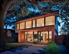 Nestled under a giant oak tree, this modern beauty is perfectly positioned to soak up all of the Texas sunlight.