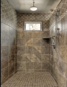 gorgeous slate tile shower for a small bathroom. I absolutely love ...