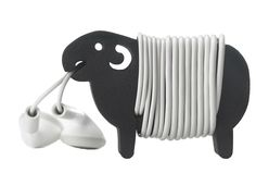 "Hiroshi Seki's Sheep is a small spongy holder that comes in two sizes. It's shaped like a shorn sheep, around which you can roll your cable to create its ""woolly"" coat. There are notches by its legs to ensure the cable stays snug, plus another in the sheep's mouth to hold the bud ends."