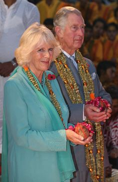 Camilla, Duchess of Cornwall and Prince Charles, Prince of Wales are presented with a gift as they take part in an Aarti ceremony at the Parmarth Niketan Temple on day 1 of an official visit to India on 06.11.13