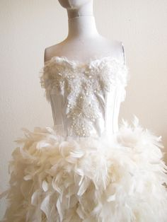 I doubt I'd ever wear it, but i LOVE it - Ivory Wedding reception skirt with Boa Feathers and by CGHeaven, $199.00
