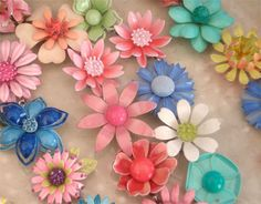 "Vintage Enameled Flower Brooches - still can't  get used to things from the 60's being called ""vintage!"" Seems like that term should be for something from the early 1900's and earlier. Then I wouldn't feel so old!"