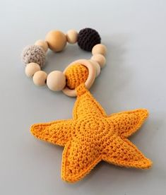 Ravelry: Starfish teething ring pattern by Larissa Boon Crochet Baby Toys, Crochet Diy, Unique Crochet, Easy Crochet Patterns, Amigurumi Patterns, Baby Patterns, Crochet Starfish, Wooden Teething Ring, Stuffed Toys Patterns