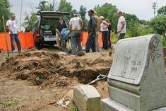 The remains of a 6-year-old girl who was murdered 30 years ago were exhumed from Washington Park Cemetery in Berkeley and taken to the medical examiner's office on June 17, 2013. Forensic scientists at the St. Louis morgue will try to extract fresh DNA and consider whether specialized testing out-of-state might shed light on the girl's identity. (J.B. Forbes, St. Louis Post-Dispatch)