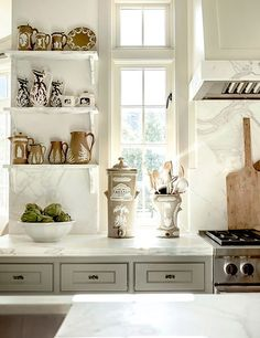 On the open marble shelving of this Tulsa, Oklahoma, kitchen, intricate Victorian jasperware lends a touch of romance.