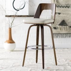 Features:  -Wood.  -Walnut finish.  -PU leather upholstery.  Frame Material: -Wood.  Frame Finish: -Walnut.  Seat Material: -Faux leather.  Style: -Mid-Century/Modern.  Seat Style: -Bucket.  Eco-Frien
