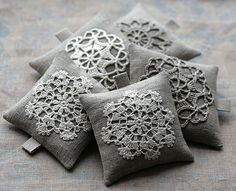 Idea to make pillows out of doilies? Looks adorable, but I would need to find big doilies... *shrug*