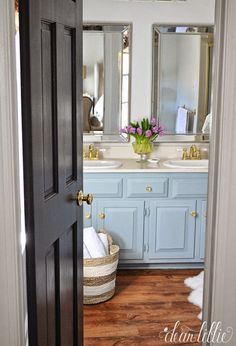Replacing a builder grade mirror with two individual mirrors like these @HomeGoods ones, helps really update and older bathroom. Here is a very simple inexpensive mini makeover on a master bathroom. Includes a Cost Breakdown and Some Tips on Sprucing up a Small Bathroom. (sponsored pin)
