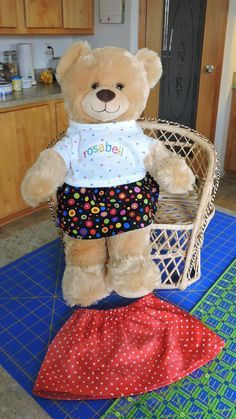 Kathy's 10-minute Build-a-Bear skirt: Cut a strip of fabric approximately 7 1/2 by 24 inches. (Or use a fat quarter and make the width about 22 inches. The bear won't care if her skirt isn't quite so full.) Make a casing for elastic on one long edge. Hem the other long edge. Cut a piece of elastic 12 inches long and insert through casing. Stitch the back seam.