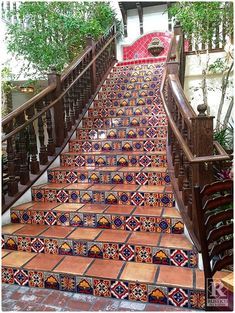 Mexican Tile Staircase - Any Mexican food restaurant needs a GRAND staircase like this one!  The stair tread tile is handmade terra cotta tile.  Talavera tile serves as the stair risers.  The look is completed by a Cantera stone fountain that sits at the top of these stairs in this Mexican food restaurant - Pancho's Las Vegas. Get this look from Rustico Tile and Stone. Not only do we offer wholesale prices, but we also ship WORLDWIDE!