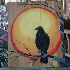 Sunset and a raven palletwood  art by Stacie Sheets